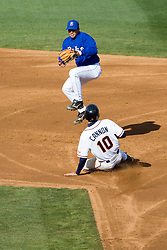 Virginia Cavaliers infielder Tyler Cannon (10) helps to break up a double play against Duke. The Virginia Cavaliers Baseball team fell to the Duke Blue Devils 13-9 in the second of a three game series at Davenport Field in Charlottesville, VA on April 7, 2007.