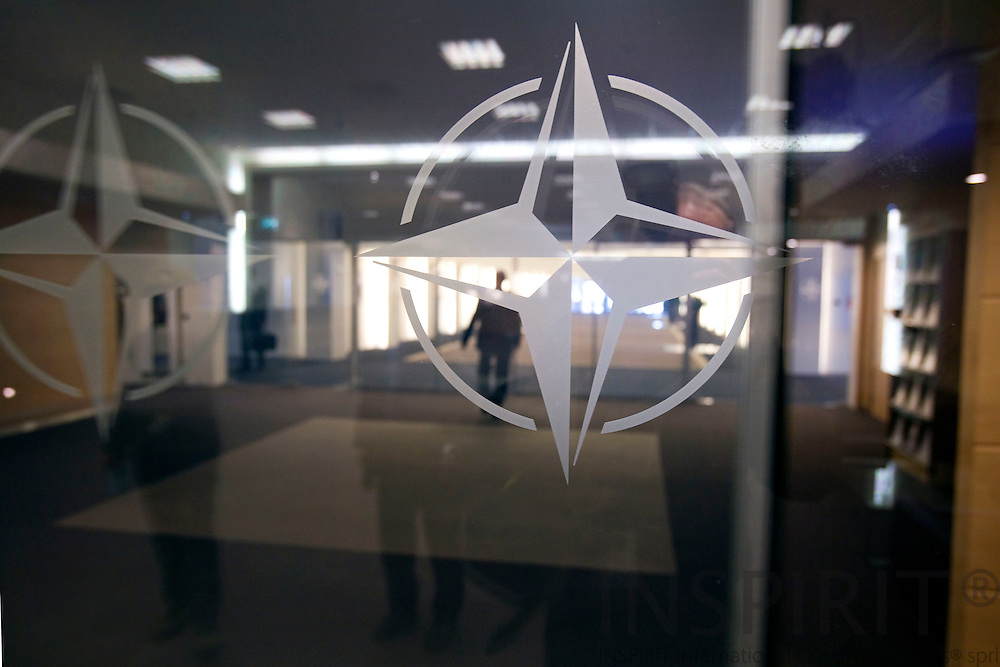 BRUSSELS - BELGIUM - 06 MARCH 2009 --  The NATO Headquarters. Here logos in the glass doors at the main building. Photo: Erik Luntang