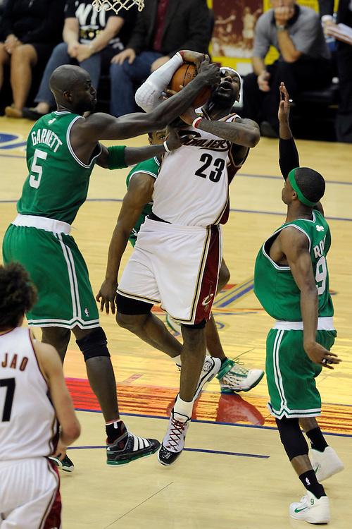 May 1, 2010; Cleveland, OH, USA; Cleveland Cavaliers forward LeBron James (23) tries to shoot over Boston Celtics forward Kevin Garnett (5) and guard Rajon Rondo (9) during the fourth quarter of game one in the eastern conference semifinals in the 2010 NBA playoffs at Quicken Loans Arena. The Cavaliers beat the Celtics 101-93. Mandatory Credit: Dave Miller-US PRESSWIRE