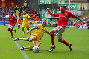 Barry Fuller (captain) of AFC Wimbledon tackles Ricky Holmes of Charlton Athletic during the EFL Sky Bet League 1 match between Charlton Athletic and AFC Wimbledon at The Valley, London, England on 28 October 2017. Photo by Toyin Oshodi.