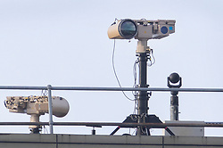 © Licensed to London News Pictures. 21/12/2018. Gatwick, UK. Equipment believed to be for tracking and jamming drones has been installed on the roof of a building at Gatwick Airport as flights resume. Further delays are expected today after two days of disruption due to multiple sightings of drones over the airfield. Thousands of passengers have been stranded as flights have been cancelled or diverted. Police are still hunting the drone operator. Photo credit: Peter Macdiarmid/LNP