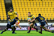 Ihaia West runs with the ball during the super rugby union  game between Hurricanes  and Highlanders, played at Westpac Stadium, Wellington, New Zealand on 24 March 2018.  Hurricanes won 29-12.