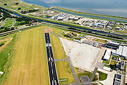 Nederland, Noord-Holland, Den Helder, 05-08-2014; Vliegveld de Kooy (Marinevliegkamp de Kooy), oorsprong vliegveld van de Marine Luchtvaartdienst. Tegenwoordig ook in gebruik voor offshore helikoptervluchten.<br /> Den Helder Airport, originally airport for Naval Aviation. Nowadays also in use for offshore helicopter operations.<br /> luchtfoto (toeslag op standard tarieven);<br /> aerial photo (additional fee required);<br /> copyright foto/photo Siebe Swart