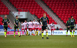 Rory Gaffney of Bristol Rovers and teammates cuts dejected figures after conceding a goal while Doncaster Rovers celebrate - Mandatory by-line: Robbie Stephenson/JMP - 27/01/2018 - FOOTBALL - The Keepmoat Stadium - Doncaster, England - Doncaster Rovers v Bristol Rovers - Sky Bet League One