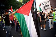 Mainz | 18 July 2014<br /> <br /> Am Samstag (18.07.2014) nahmen etwa 1000 M&auml;nner, Frauen und Kinder in der Innenstadt von Mainz anl&auml;sslich der milit&auml;rischen Auseinandersetzung zwischen Israel und der Hamas in Gaza an einer Solidarit&auml;tsdemonstration f&uuml;r Gaza, ein freies Pal&auml;stina und gegen Israel teil. Bei der Demo wurden Fahnen der Hamas und der Hisbollah mitgef&uuml;hrt, neben den &uuml;blichen Parolen gegen Israel wurde in Sprechch&ouml;hren auch vereinzelt zur Vernichtung von J&uuml;dinnen und Juden aufgerufen.<br /> Hier: Teilnehmer der Demo mit Pal&auml;stina-Fahnen, rechts ein Plakat mit der Aufschrift &quot;Nein zum Zionismus&quot;.<br /> <br /> <br /> &copy;peter-juelich.com<br /> <br /> [No Model Release | No Property Release]