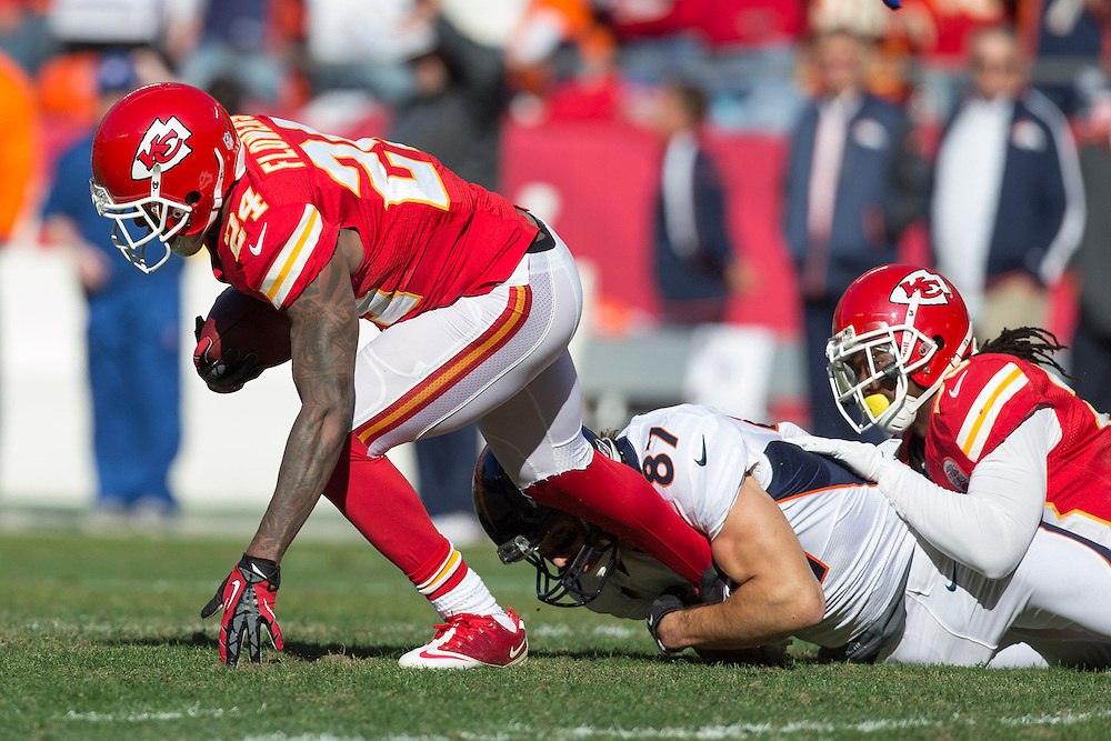 KANSAS CITY, MO - NOVEMBER 25: Brandon Flowers #24 of the Kansas City Chiefs is grabbed by the ankle by Eric Decker #87 of the Denver Broncos after intercepting a pass at Arrowhead Stadium on November 25, 2012 in Kansas City, Missouri.  The Broncos defeated the Chiefs 17-9. (Photo by Wesley Hitt/Getty Images) *** Local Caption *** Brandon Flowers; Eric Decker