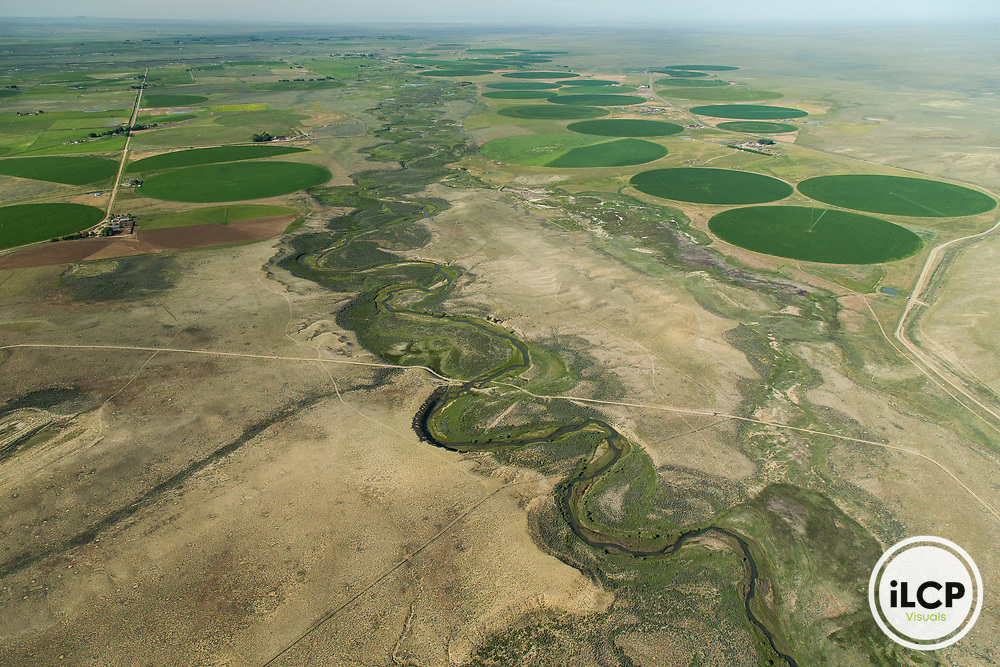 Alfalfa farming area in Sweet Water County in Wyoming from aerial perspective. The farm has removed thousand of acres that were once healthy sagebrush from the area.