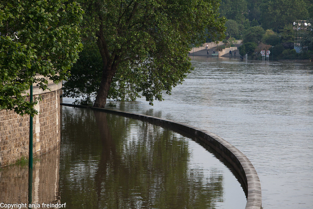 Flooding of river Seine, may cost French insurance companies more than $2 billion, The Seine's water levels fell Sunday as rains eased. A reading indicated it was near the mark, reached in 1982, of 20.27 feet above its normal level, the Environment and Energy Ministry reported. France creates emergency fund for people affected by floods. About 6,000 French homes remained without electricity Monday, and several train stations and roads were still closed in the French capital and surrounding towns. Flooded city street