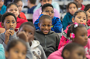 Students listen to comments during a Touchdown Houston Read On literacy program at Ross Elementary School, December 2, 2016.