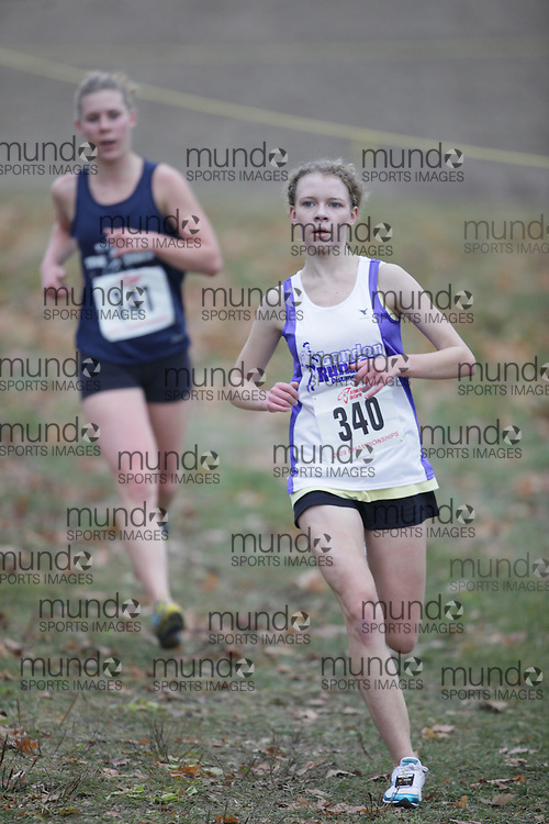 King City, Ontario ---09-11-15--- Kaitlyn Komarnicky of the London Runner Distance Club competes at the Athletics Ontario Cross Country Championships in King City, Ontario, November 16, 2009..GEOFF ROBINS Mundo Sport Images