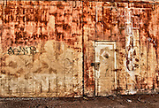 Rusted garage door in alley in downtown Phoenix, Az