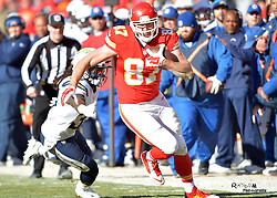 Dec 28, 2014; Kansas City, MO, USA; Kansas City Chiefs tight end Travis Kelce (87) runs the ball as San Diego Chargers defensive back Jahleel Addae (37) attempts the tackle during the first half at Arrowhead Stadium. The Chiefs won 19-7. Mandatory Credit: Denny Medley-USA TODAY Sports