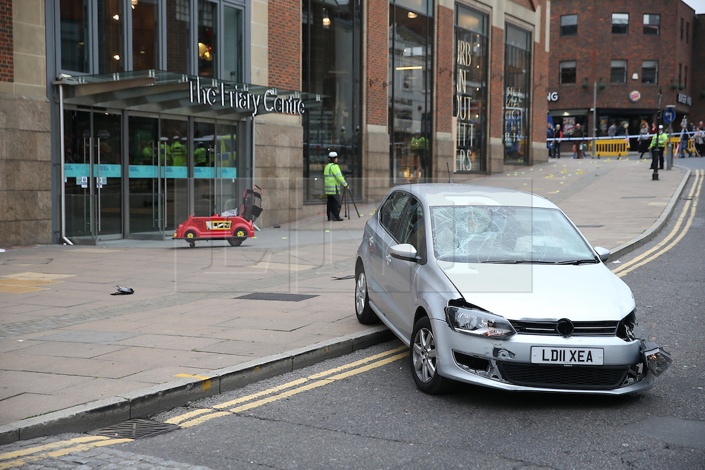 © Licensed to London News Pictures. 23/10/2015. Guilford, UK. Emergency services at the scene in Guildford, Surrey, where a VW Polo car is reported to have been involved in collision with a number of pedestrians.  Photo credit: Peter Macdiarmid/LNP