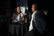 "Reporter Lindsay Christians laughs with guest Nyanyika Banda during the ""Corner Table Podcast"" recording at Old Sugar Distillery in Madison, Wisconsin, Tuesday, June 18, 2019."