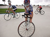 Max Thilen, center, Daniel Jimenez, 17, rigth, and Carlos Rocha, 17, are riding their bicycles at the Bryan Piccolo park's velodrome on Monday June 29, 2009. Staff photo/Cristobal Herrera.