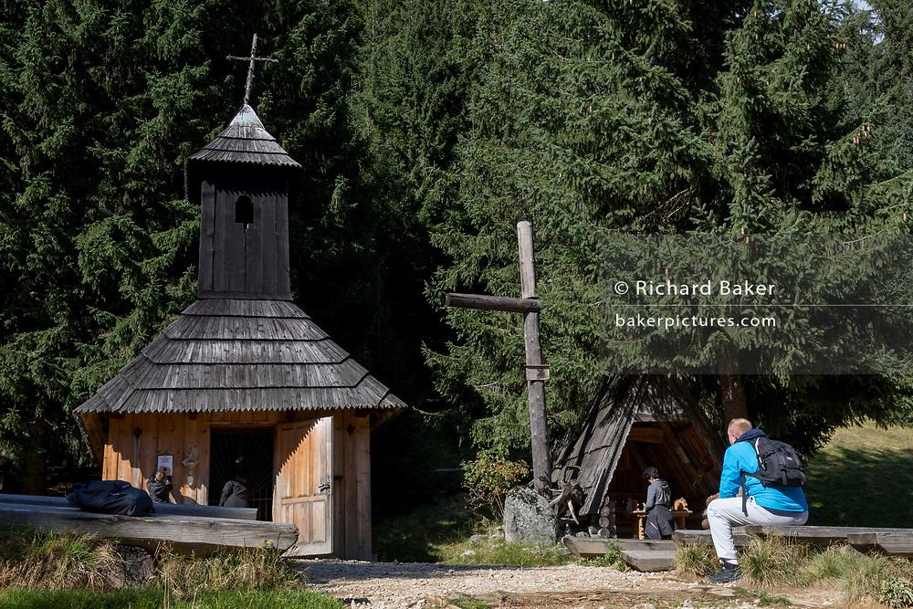 Pilgrims visit the small chapel of St. Jana Chrzciciela at the top of Polana Chocholowska a hiking route on Dolina Chocholowska in the Tatra National Park, on 17th September 2019, near Zakopane, Malopolska, Poland.