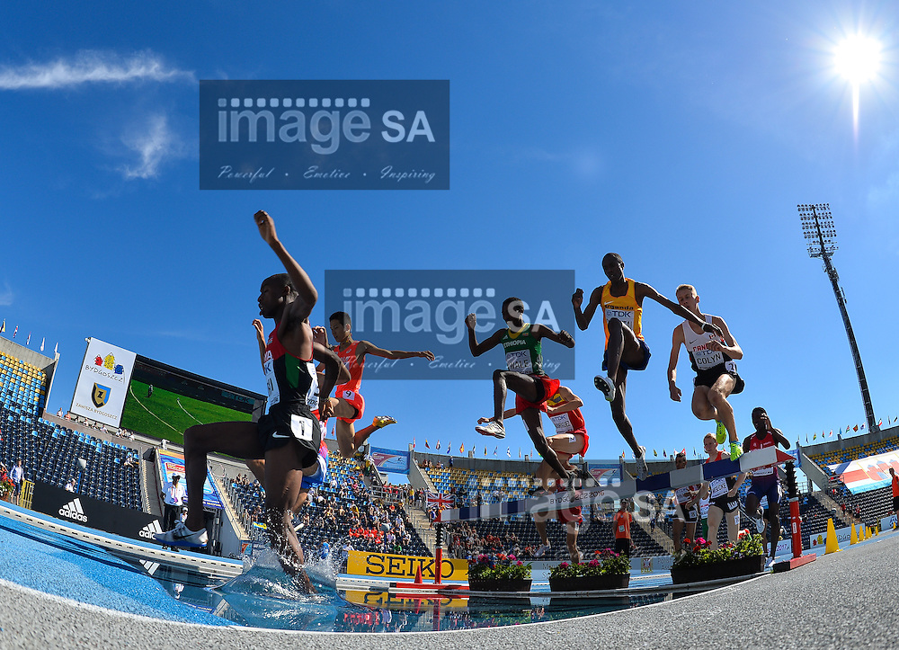 BYDGOSZCZ, POLAND - JULY 21: Amos Kirui of Kenya leads the pack at the water jump in the mens 3000m steeplechase during day 3 of the IAAF World Junior Championships at Zawisza Stadium on July 21, 2016 in Bydgoszcz, Poland. (Photo by Roger Sedres/Gallo Images)