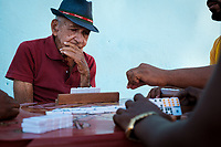 TRINIDAD, CUBA - CIRCA JANUARY 2020: People playing Dominoes in the streets of Trinidad.