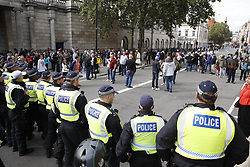 © Licensed to London News Pictures. 07/09/2019. London, UK. Police form a line to stop far right protestors reaching a Pro-EU rally in Whitehall, central London. Photo credit: Peter Macdiarmid/LNP