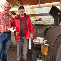 Pat Haugh and Andy Gutherie from Lisdoonvarna cooking the BBQ during the family fun day at the enjoying the family fun day during the Opening of restored Spa Well in Lisdoonvarna