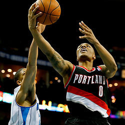 Feb 13, 2013; New Orleans, LA, USA; New Orleans Hornets power forward Anthony Davis (23) blocks a shot by Portland Trail Blazers point guard Damian Lillard (0) during the second half of a game at the New Orleans Arena. The Hornets defeated the Trail Blazer 99-63. Mandatory Credit: Derick E. Hingle-USA TODAY Sports