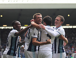 Gareth McAuley of West Bromwich Albion (C) celebrates scoring his sides first goal - Mandatory by-line: Jack Phillips/JMP - 20/08/2016 - FOOTBALL - The Hawthorns - West Bromwich, England - West Bromwich Albion v Everton - Premier League