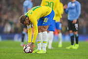 Brazil forward Neymar Jr (10) puts the ball on the penalty spot before taking a penalty kick during the Friendly International match between Brazil and Uruguay at the Emirates Stadium, London, England on 16 November 2018.