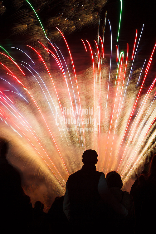 Basingstoke,Hampshire,UK. 5th November 2013<br /> <br /> A couple admiring a firework display on Guy Fawkes night<br /> <br /> Photo by Rob Arnold