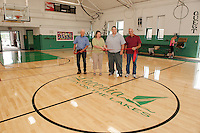 Councilor Armand Bolduc, Asst Director Amy Lovisek, Director Kevin Dunleavy and Councilor Bob Hamel during the ribbon cutting for the new gym floor at Laconia Community Center Monday morning.  (Karen Bobotas/for the Laconia Daily Sun)