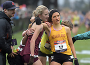 Dec 1, 2018; Portland, OR, USA; Kelsey Chmiel (121) of Kinetic and Emily Covert (17) of Heartland embrace after the girls race during the Nike Cross Nationals at Glendoveer Golf Course.