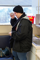 1/27/15 11:01:14 AM -- Louisa, KY, U.S.A  -- Cheryl Castle, uses a magnet from her NeuroPace device to record data after having symptoms of a seizure during a office visit for her son Nate. Nate was complaining of a cough and had a low grade fever. <br /> <br /> Cheryl is a recent recipient of the high-tech device, can now do many tasks she was unable to do when her epileptic seizures became more severe and more frequent. Now she's getting back to a normal life.<br /> <br />  --    Photo by Jonathan Palmer, Freelance