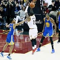 09 June 2017: Cleveland Cavaliers guard Kyrie Irving (2) takes a jump shot over Golden State Warriors guard Patrick McCaw (0) and Golden State Warriors forward Kevin Durant (35) during the Cleveland Cavaliers 137-11 victory over the Golden State Warriors, in game 4 of the 2017 NBA Finals, at  the Quicken Loans Arena, Cleveland, Ohio, USA.