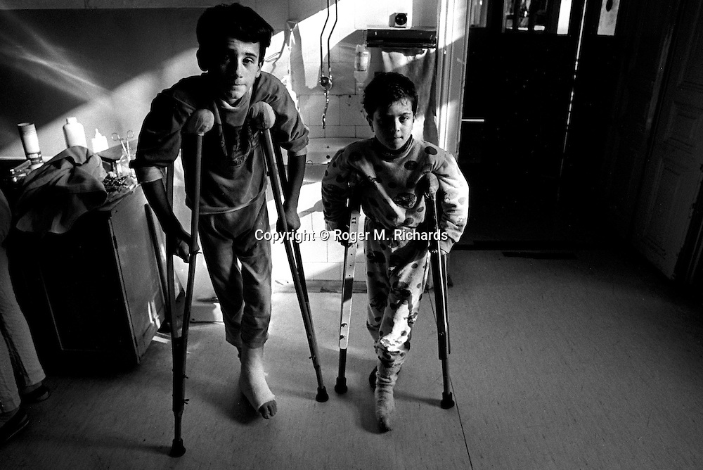 Two young boys recovering from shrapnel wounds caused by Serb shells, Kosevo hospital, Sarajevo, Bosnia-Herzegovina, February 1993. PHOTO BY ROGER RICHARDS