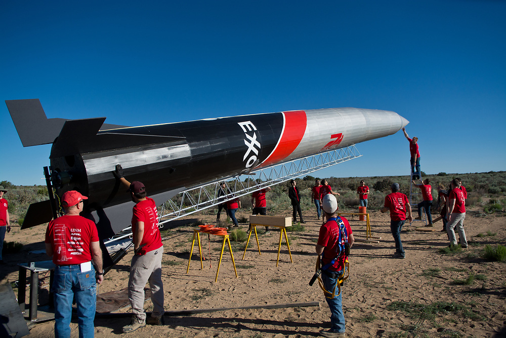 Students in Lobo Launch, a mechanical engineering class at the University of New Mexico, work to raise their 47 feet high rocket into launch position at their launch site in Rio Rancho, Saturday, May 27, 2017. (Marla Brose/Albuquerque Journal)