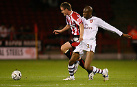 Photo: Steve Bond.<br /> Sheffield United v Arsenal. Carling Cup. 31/10/2007. Michael Tonge (L) grabs a handful of Abou Diaby (R)
