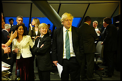 Boris Johnson watches the results come in late at night with his son, in City Hall, London, UK, May 5, 2012. Photo By Andrew Parsons/i-Images.