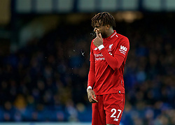 LIVERPOOL, ENGLAND - Sunday, March 3, 2019: Liverpool's Divock Origi empties his nostrils during the FA Premier League match between Everton FC and Liverpool FC, the 233rd Merseyside Derby, at Goodison Park. (Pic by Paul Greenwood/Propaganda)