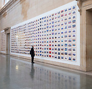 Steve McQueen Year 3 Exhibition<br /> at Tate Britain, London, Great Britain <br /> Press view <br /> 11th November 2019 <br /> <br /> The Turner Prize-winning artist and Oscar-winning filmmaker has created one of the most ambitious visual portraits of citizenship ever undertaken in one of the world's largest cities. Using the medium of the traditional school class photograph, this installation brings together images of tens of thousands of Year 3 pupils from across London. It offers us a glimpse of the city's future - a hopeful portrait of a generation to come.<br />  <br /> A group of over 40 schoolchildren from Tyssen Community School in Hackney viewing the artwork and their own class photograph<br /> <br /> Visitors interacting with large magnifying glasses as part of the installation<br /> <br /> A portrait of Turner Prize-winning artist and Oscar-winning filmmaker Steve McQueen with Tyssen Community School in the Duveens Galleries <br /> <br /> <br /> <br /> Photograph by Elliott Franks