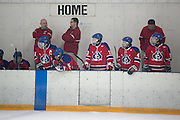Fairport coaches watch from the bench during a scrimmage against Victor at Thomas Creek in Fairport on Monday, November 24, 2014.