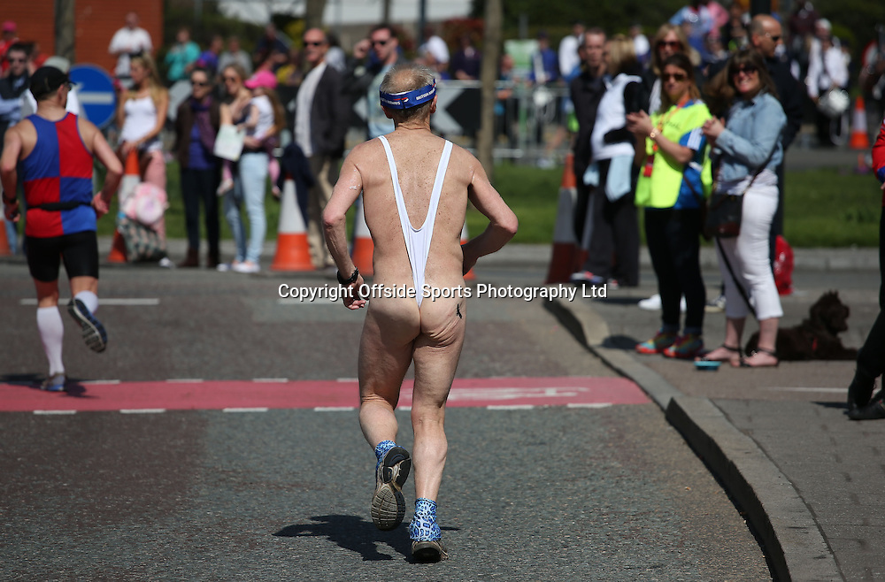 21 April 2013 London Marathon - a runner possibly too old for wearing a thong.<br /> <br /> <br /> Photo: Mark Leech