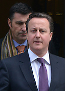 © Licensed to London News Pictures. 13/02/2013. Westminster, UK British Prime Minister David Cameron leaves Downing Street today 13th February 2013 for Prime Ministers Questions at The Houses of Parliament. Photo credit : Stephen Simpson/LNP