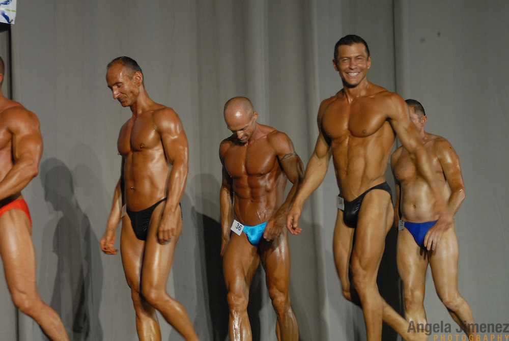 Competitors in the 40-49 year old age group lightweight division Physique (bodybuilding) competition leave the stage after posing at  McGaw Memorial Hall/Welsh-Ryan Arena at Northwestern University in Evanston, Illinois during the Gay Games VII competition on July 19, 2006. <br />  <br /> <br /> Over 12,000 gay and lesbian athletes from 60 countries are in Chicago competing in 30 sports during the Games from July 15 through 22, 2006. <br /> <br /> Over 50,000 athletes have competed in the quadrennial Games since they were founded by Dr. Tom Wadell, a 1968 Olympic decathlete, and a group of friends in San Francisco in 1982, with the goal of using athletics to promote community building and social change. <br /> <br /> The Gay Games resemble the Olympics in structure, but the spirit is one of inclusion, rather than exclusivity. There are no qualifying events or minimum or maximum requirements.<br /> <br /> The Games have been held in Vancouver (1990), New York (1994), Amsterdam (1998), and Sydney (2002).