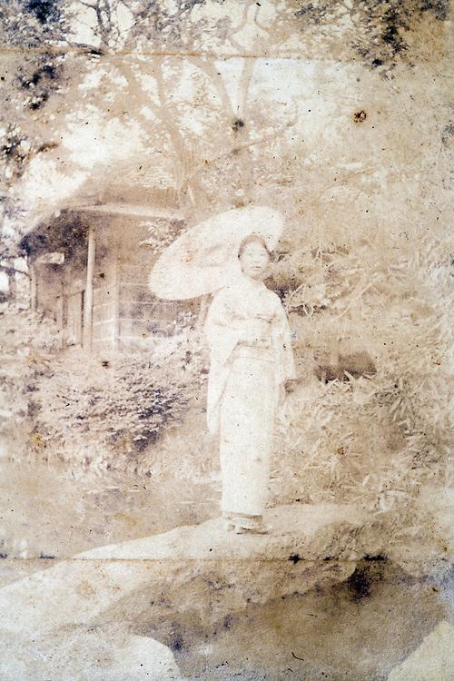 extreme deteriorating female waering kimono portrait in outdoors tradional Japanese garden ca 1930s
