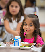 Students are served lunch at Walnut Bend Elementary School, July 17, 2014.