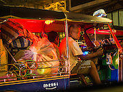 30 OCTOBER 2014 - BANGKOK, THAILAND: A tuk-tuk being used to haul merchandise to a market on Rama I Street in Bangkok. Tuk-tuks are used throughout Asia as taxis and freight haulers.    PHOTO BY JACK KURTZ