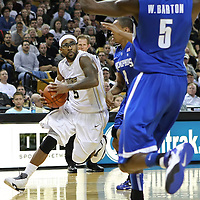 Central Florida guard Marcus Jordan (5) drives to the basket against Memphis guard Charles Carmouche (4) and Memphis guard Will Barton (5) during a Conference USA NCAA basketball game between the Memphis Tigers and the Central Florida Knights at the UCF Arena on February 9, 2011 in Orlando, Florida. Memphis won the game 63-62. (AP Photo: Alex Menendez)