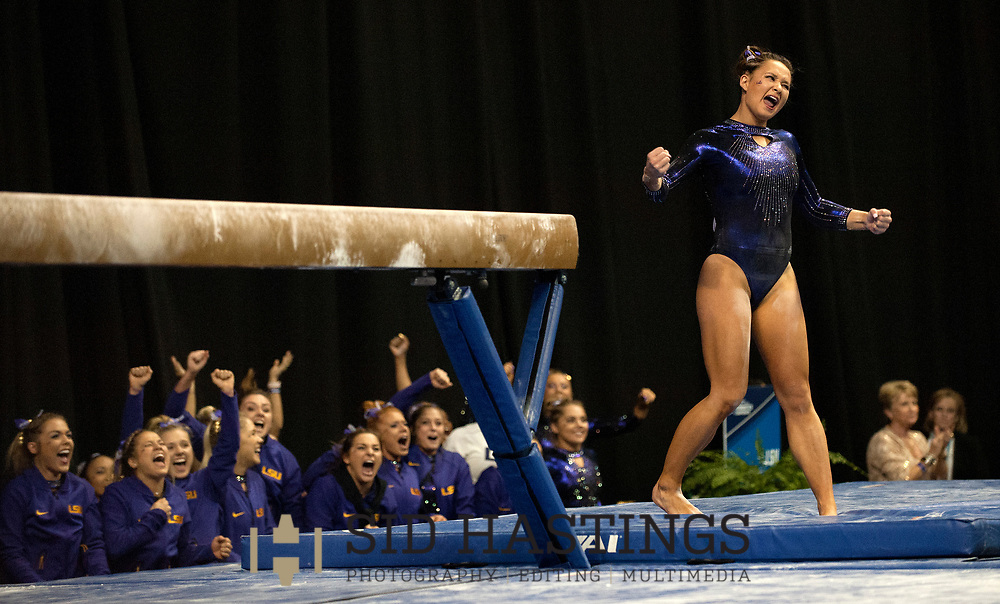 21 APRIL 2018 -- ST. LOUIS -- LSU gymnast Sarah Finnegan and her coaches and teammates celebrate after Finnegan completed her turn on the Beam during the 2018 NCAA Women's Gymnastics Championship Super Six at Chaifetz Arena in St. Louis Saturday, April 21, 2018.<br /> Photo &copy; copyright 2018 Sid Hastings.