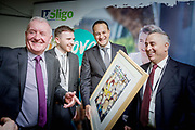 Barry Clohessy, President Students Union, IT Sligo, Tony McLoughlin TD, Taoiseach and Minister for Defence Leo Varadkar is presented with an Annie West caricature of the cabinet by IT Sligo President Brendan McCormack at the Cabinet meeting and launch of Project Ireland 2040 at IT Sligo.<br /> Photo: James Connolly<br /> 16FEB18
