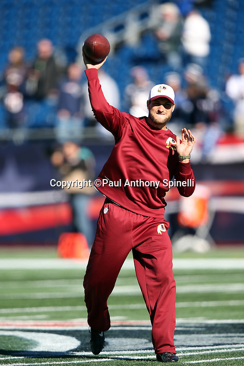 Washington Redskins quarterback Kirk Cousins (8) throws a pass while warming up before the 2015 week 9 regular season NFL football game against the New England Patriots on Sunday, Nov. 8, 2015 in Foxborough, Mass. The Patriots won the game 27-10. (©Paul Anthony Spinelli)