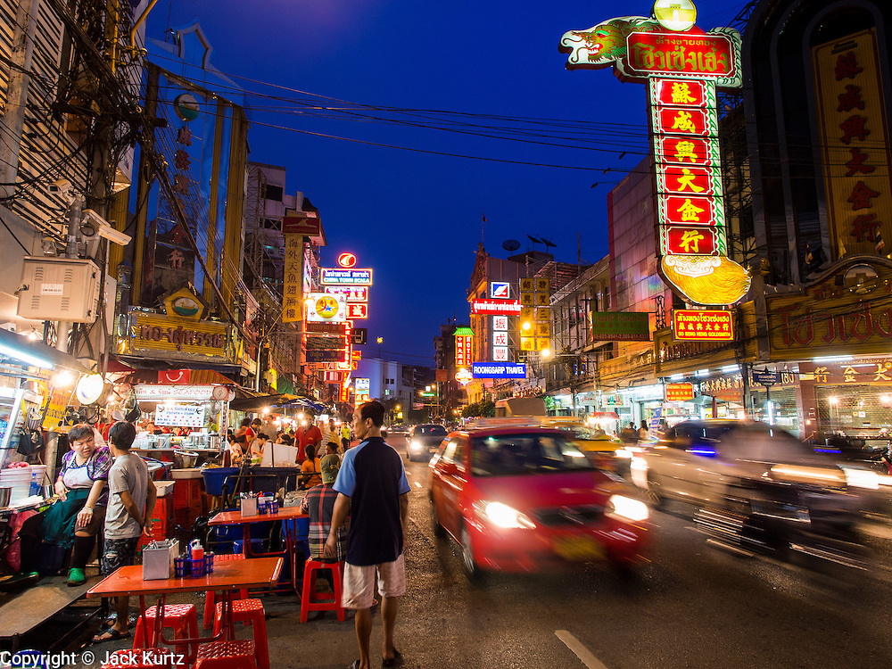 11 SEPTEMBER 2013 - BANGKOK, THAILAND:  Evening traffic on Yaowarat Road in the Chinatown section of Bangkok. Thailand in general, and Bangkok in particular, has a vibrant tradition of street food and eating on the run. In recent years, Bangkok's street food has become something of an international landmark and is being written about in glossy travel magazines and in the pages of the New York Times.        PHOTO BY JACK KURTZ